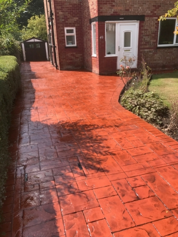 Terra-cotta with charcoal release printed driveway Timperley