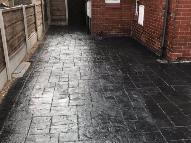 New classic grey concrete driveway in Stretford