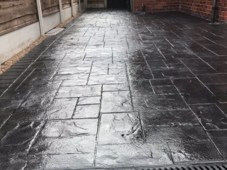 New classic grey concrete driveway in Stretford
