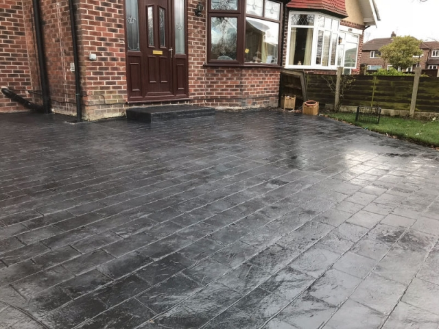 New classic grey concrete driveway in Urmston