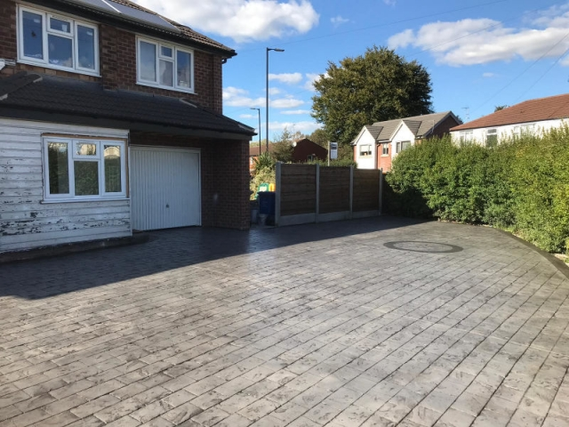 New pattern imprinted concrete driveway in Timperley