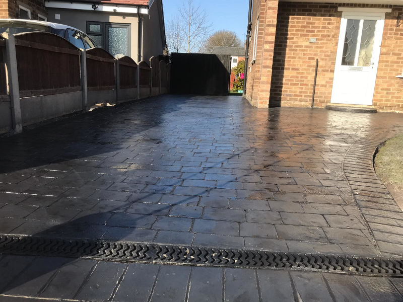 New pattern imprinted concrete driveway in Brooklands