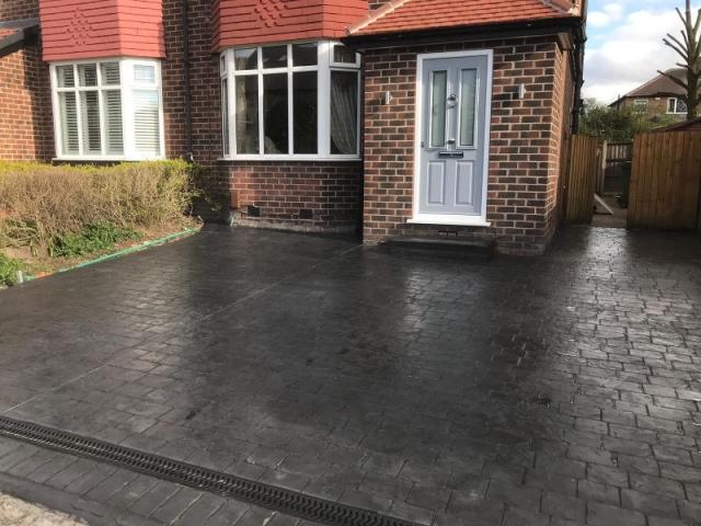 New pattern imprinted concrete driveway