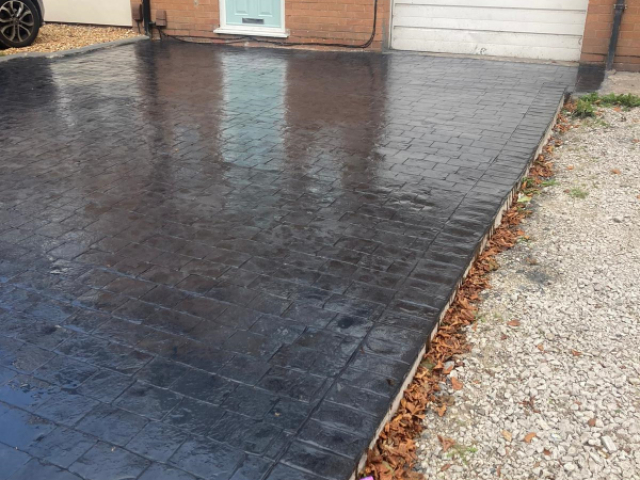 New pattern imprinted concrete driveway by Lasting Impressions Driveways